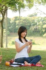 A college student on campus with smartphone